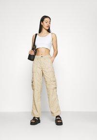 BDG Urban Outfitters - MARBLE SKATE JEAN - Pantaloni - beige - 1