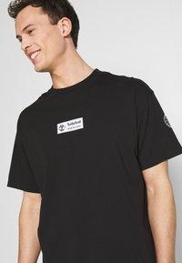 Timberland - STATEMENT PRINT TEE - Print T-shirt - black - 3