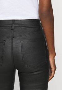 Object Tall - OBJBELLE COATED - Bootcut jeans - black - 2