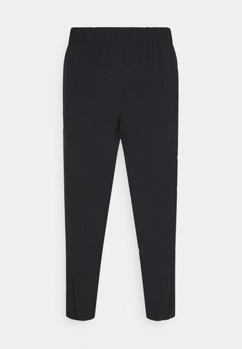 CURRY WARMUP - Tracksuit bottoms - black