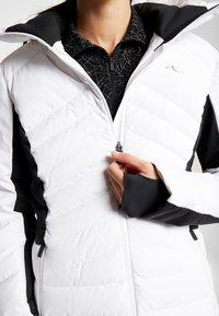 Kjus - WOMEN DUANA JACKET - Ski jacket - white/black - 4