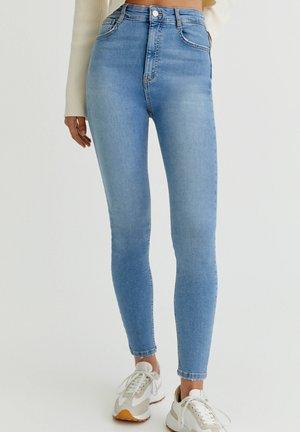 WITH VERY HIGH WAIST - Skinny džíny - mottled light blue