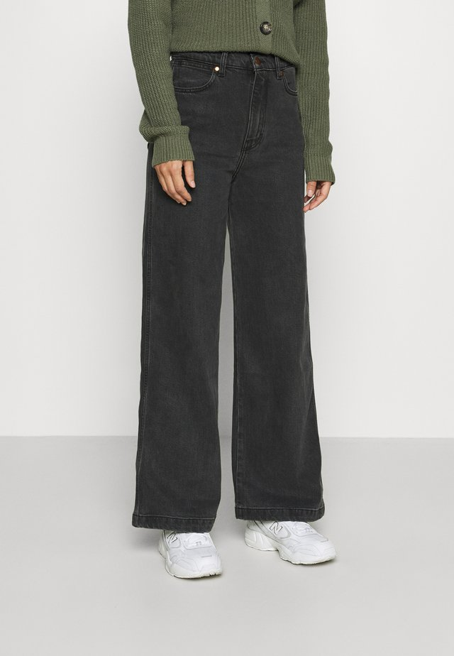 WORLDWIDE - Flared Jeans - storm