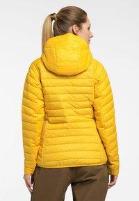 Haglöfs - Winter jacket - pumpkin yellow - 1