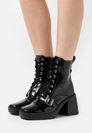 DEMONIC - Šněrovací kotníkové boty - black