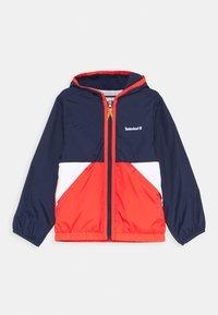 Timberland - HOODED WINDBREAKER - Light jacket - orange - 0