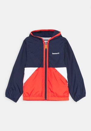HOODED WINDBREAKER - Light jacket - orange