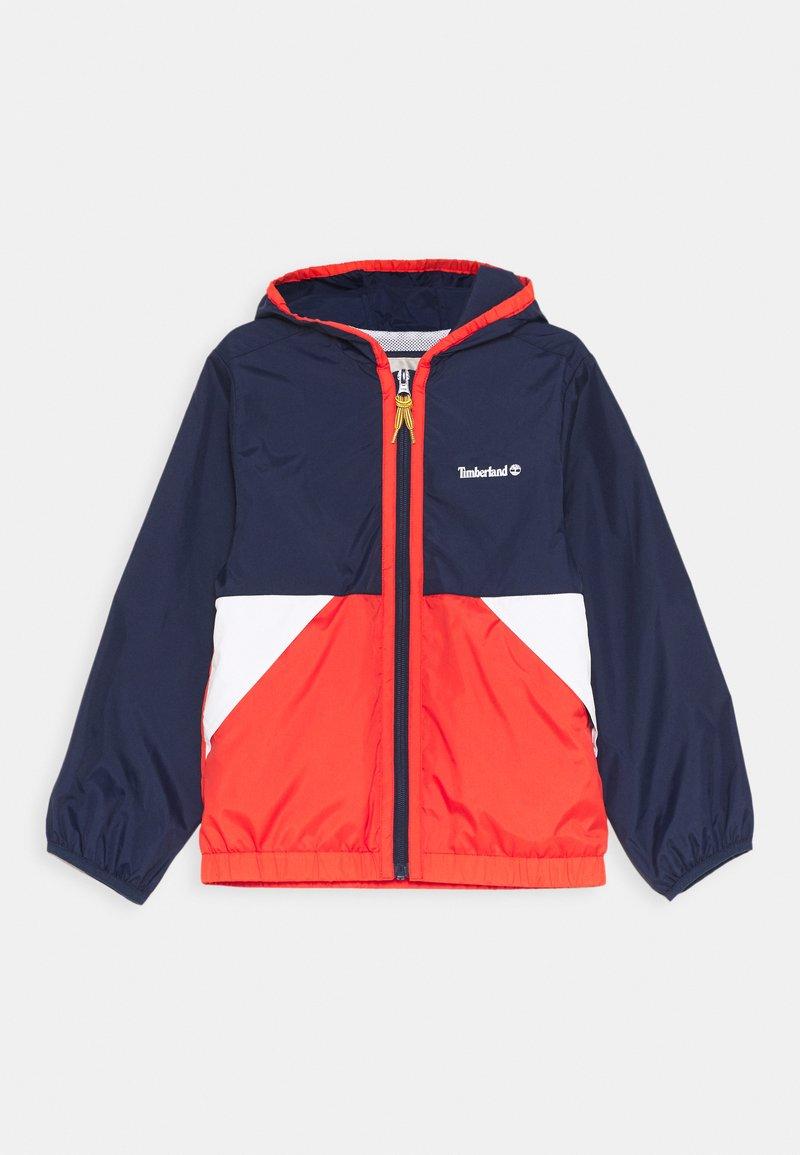 Timberland - HOODED WINDBREAKER - Light jacket - orange