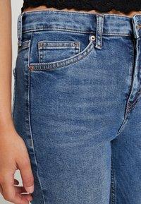 Topshop Petite - RIP HEM JAMIE - Jeans Skinny Fit - blue denim - 4