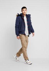Tommy Jeans - TECH JACKET - Winter jacket - black iris - 1