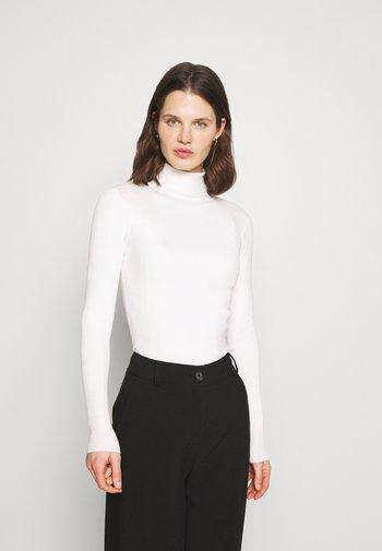 NEW ROLL - Stickad tröja - beige
