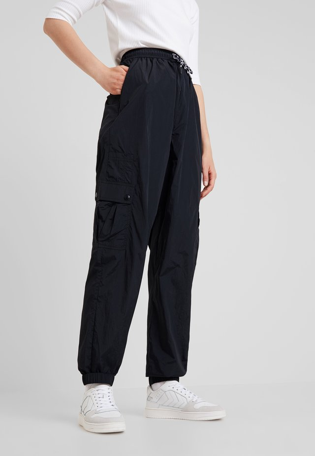 CLEO PANTS - Verryttelyhousut - black