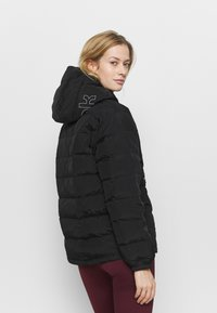 Reebok - Down jacket - black - 2
