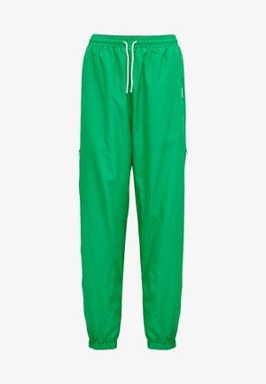 HMLCHRISTAL  - Tracksuit bottoms - bright green