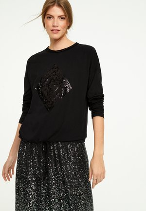 Long sleeved top - black sequins