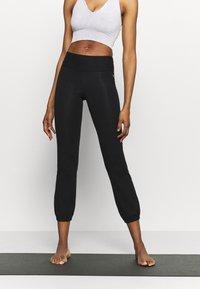 Deha - JOGGER PANTS - Tracksuit bottoms - black - 0