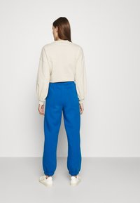 Gestuz - RUBI PANTS - Tracksuit bottoms - french blue - 2
