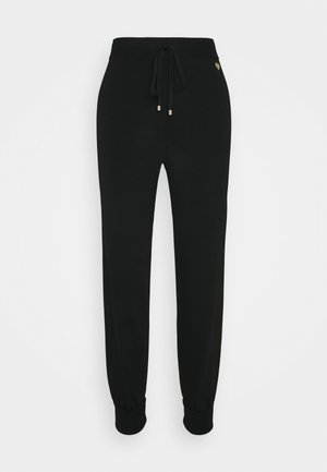 PANTALONE IN MAGLIA UNITA - Pantalones deportivos - nero