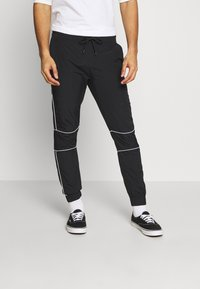 Jack & Jones - JJINEEDO PANTS - Pantalones deportivos - black - 0