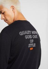 Levi's® Extra - GRAPHIC TEE - Camiseta de manga larga - black - 3