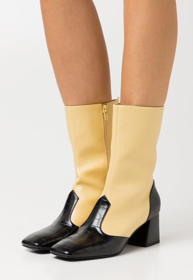 Monki - KEELY BOOT VEGAN - Classic ankle boots - yellow/black