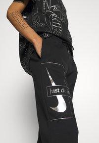 Nike Sportswear - PANT - Tracksuit bottoms - black - 5