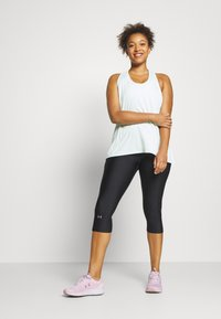 Under Armour - HIGH RISE CAPRI - 3/4 sports trousers - black - 1