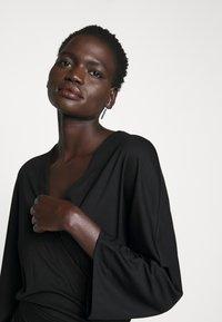 Filippa K - IRENE DRESS - Žerzejové šaty - black - 5