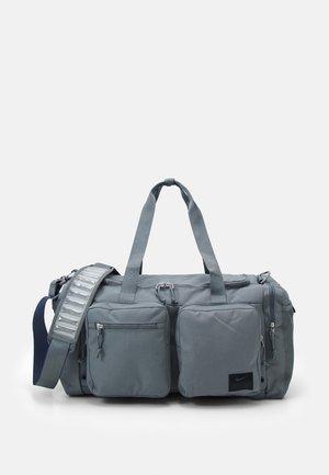 UTILITY POWER UNISEX - Sports bag - smoke grey/thunder blue