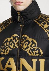 Karl Kani - RETRO REVERSIBLE PUFFER JACKET UNISEX  - Light jacket - black - 6
