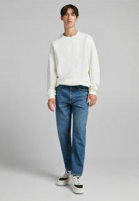 Bershka - STRAIGHT VINTAGE - Relaxed fit jeans - dark blue - 1