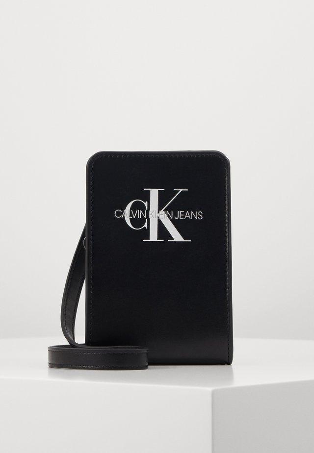 MONOGRAM POUCH BAG - Umhängetasche - black