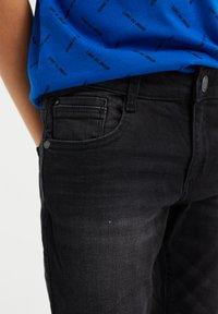 WE Fashion - Slim fit jeans - black - 2