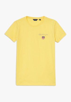 MEDIUM SHIELD  - Basic T-shirt - mimosa yellow