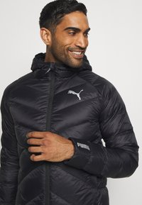 Puma - PWRWARM PACKLITE JACKET - Down jacket - black - 3