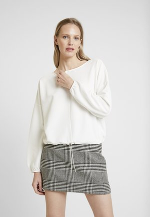 GUNETI - Long sleeved top - milk