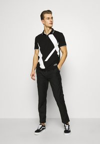 Armani Exchange - Poloshirt - black - 1