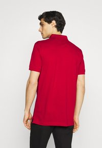 Tommy Hilfiger - 1985 REGULAR - Polo shirt - primary red - 2