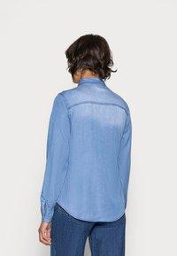 Vila - VIBISTA DENIM SHIRT - Button-down blouse - medium blue denim - 2