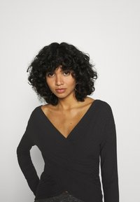 Nly by Nelly - CRISS CROSS SHOULDER - Long sleeved top - black - 5