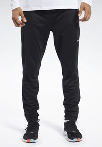 Reebok - SPEEDWICK TRACKSTER PANTS - Tracksuit bottoms - black - 0