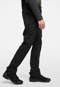 Haglöfs - BRECCIA PANT - Outdoor trousers - true black/magnetite short - 2