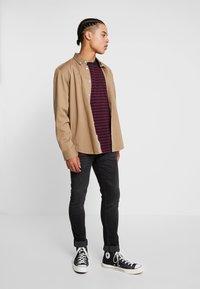Nudie Jeans - SKINNY LIN - Jeans Skinny Fit - worn black - 1