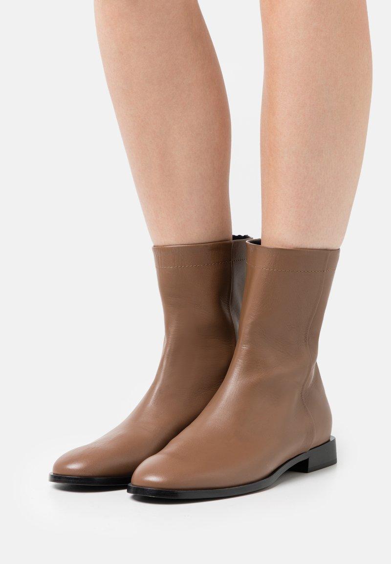 Furla - ESSENCE BOOT - Classic ankle boots - cognac