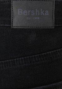 Bershka - SUPER HIGH WAIST - Slim fit jeans - black - 5
