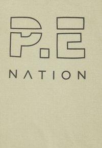 P.E Nation - HIGH TWIST SHUFFLE TANK - Top - mottled - 2