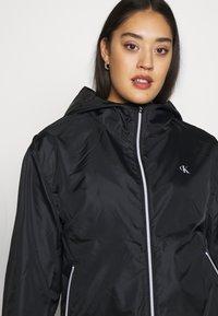 Calvin Klein Jeans Plus - PLUS LARGE CK HOODED ZIP THROUGH - Training jacket - black - 3