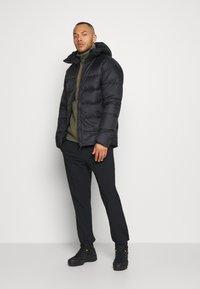 Mammut - MERON IN HOODED JACKET MEN - Down jacket - black - 1