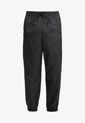OFFSET ZIPPER TRACK PANT - Trousers - black