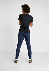 Nike Performance - DRI-FIT ACADEMY19 - Tracksuit bottoms - obsidian/white - 2